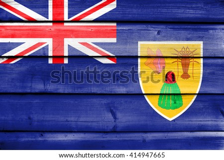 Flag of Turks and Caicos Islands, painted on old wood plank background - stock photo