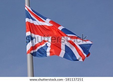 flag of United Kingdom over blue sky