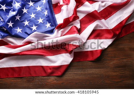 Flag of United States of America on wooden table closeup - stock photo