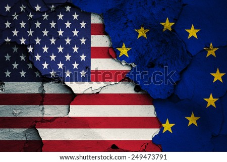 flag of USA and EU painted on cracked wall - stock photo
