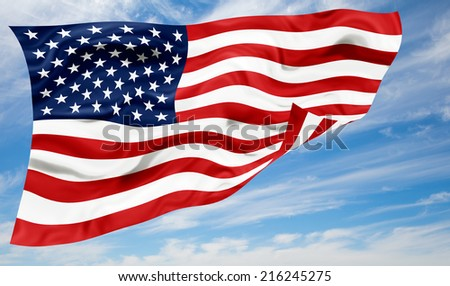 Flag of Usa fluttering in the wind, against a cloudy sky