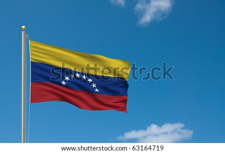 Flag of Venezuela with flag pole waving in the wind on front of blue sky - stock photo