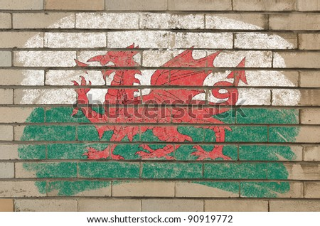 flag of wales on grunge brick wall painted with chalk - stock photo