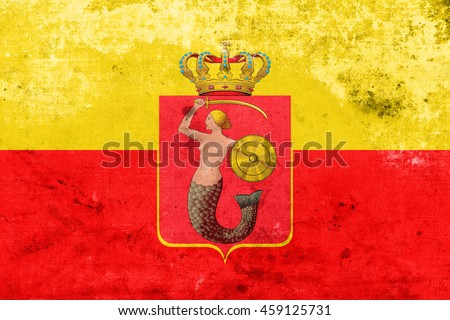 Flag of Warsaw with Coat of Arms, Poland, with a vintage and old look - stock photo