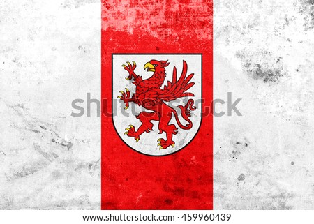 Flag of West Pomeranian Voivodeship, Poland, with a vintage and old look - stock photo