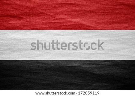 flag of Yemen or Yemeni banner on canvas texture - stock photo