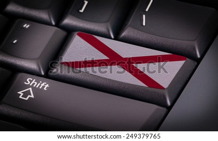 Flag on button keyboard, flag of Alabama - stock photo