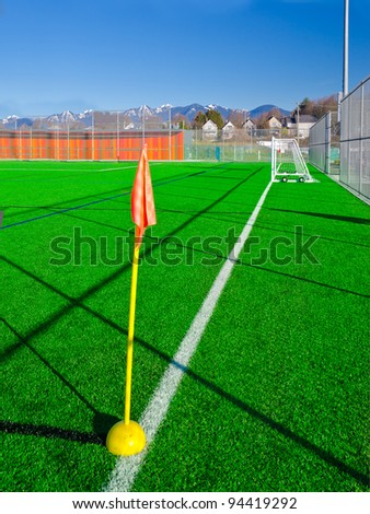 Flag on the corner of a soccer field in a bright sunny day. - stock photo
