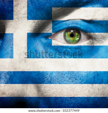 Flag painted on face with green eye to show greece support