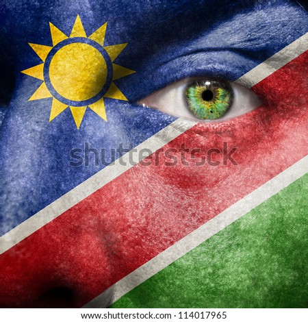 Flag painted on face with green eye to show Namibia support
