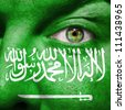 Flag painted on face with green eye to show Saudi Arabia support - stock photo