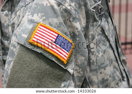flag patch on iraq war soldier uniform - stock photo
