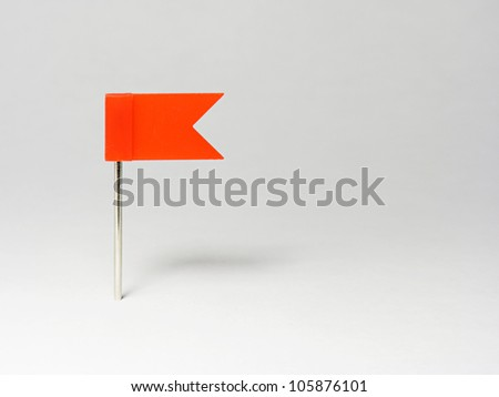 Flag pin red color on white background. - stock photo