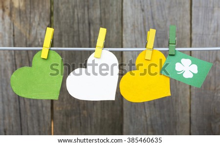 Flag Republic of Ireland on pegs ( clothespin ) wooden background. happy St Patrick's Day card, March 17 - stock photo