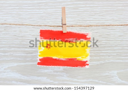 flag Spain clothespin rope wooden background - stock photo