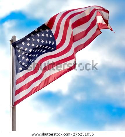 Flag USA over blue sky background - stock photo