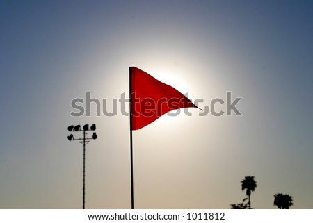Flag with sun behind - stock photo