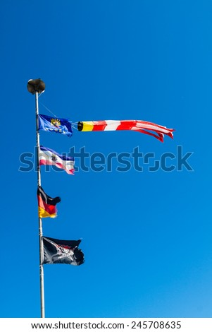 Flagpole and blue sky.