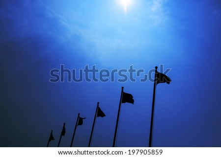 Flagpole flying silhouette - stock photo