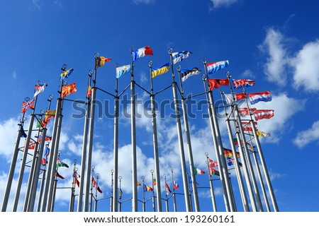 Flags against blue sky on european square in Moscow, Russian Federation - stock photo
