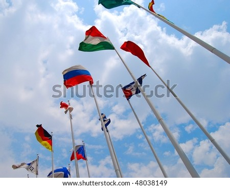 Flags against cloudy sky