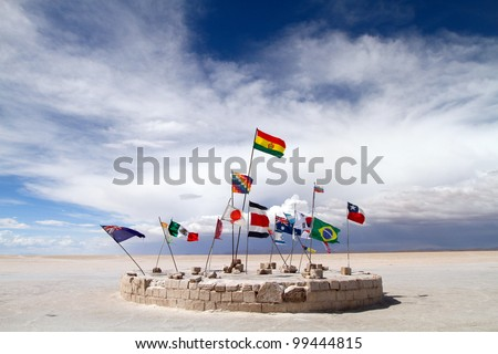 Flags at the Salar de Uyuni, Bolivia - stock photo