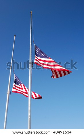 Flags fly at half staff after a soldier's death - stock photo