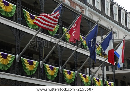 Flags flying on balcony in the French Quarters, New Orleans.