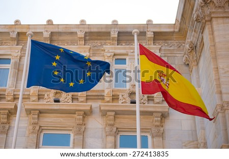flags from European Community and Spain beneath - stock photo