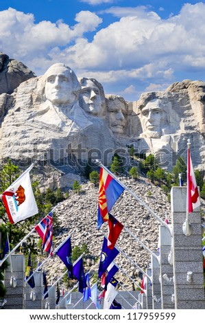 Flags from the fifty states in front of Mt. Rushmore - stock photo