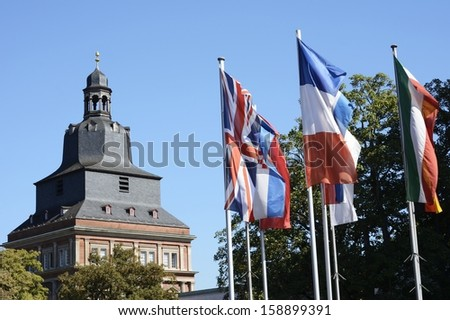 Flags in front of a historic tower in Trier (Rhineland-Palatinate, Germany)