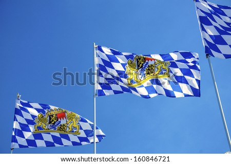 Flags of Bavaria (Germany) waving in the wind - stock photo