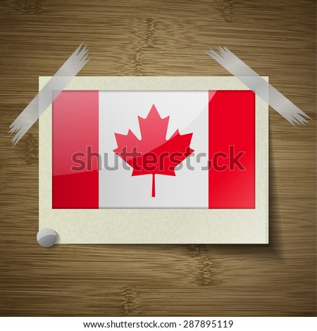 Flags of Canada at frame on wooden texture.  illustration. Rastrized version - stock photo