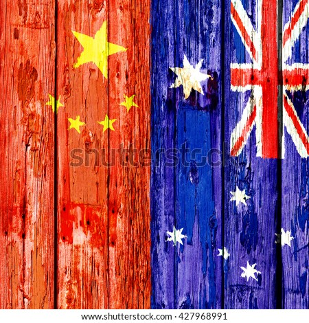 Flags of China and Australia on an old wooden door - stock photo