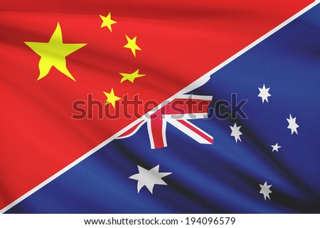 Flags of China and Commonwealth of Australia blowing in the wind. Part of a series. - stock photo