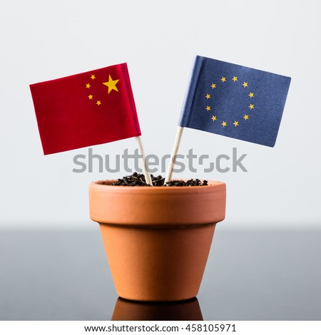 flags of china and europe in a plant pot