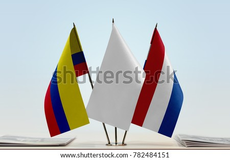 Flags of Colombia and Netherlands with a white flag in the middle