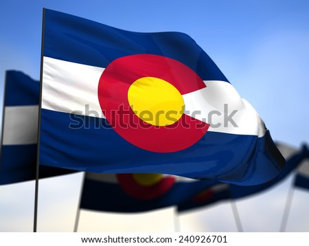 flags of Colorado on blue sky background - stock photo
