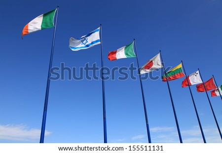 Flags of different countries waving outdoors - stock photo