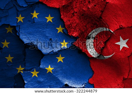 flags of EU and Turkey painted on cracked wall - stock photo