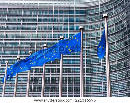 Flags of European Union in front of European Commission in Brussels, Belgium - stock photo