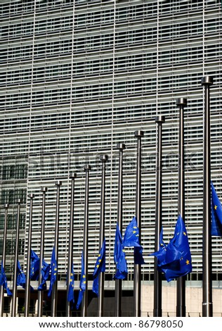 Flags of European Union in half-mast by the European Commission building - stock photo