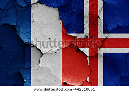flags of France and Iceland painted on cracked wall - stock photo