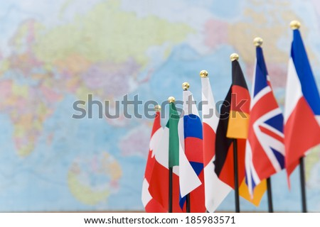 flags of G7 countries and global map