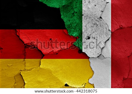 flags of Germany and Italy painted on cracked wall - stock photo