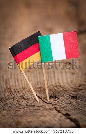 Flags of Italy and Germany on wooden background - stock photo
