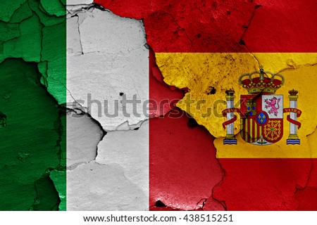 flags of Italy and Spain painted on cracked wall - stock photo