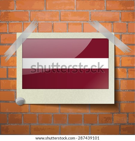 Flags of Latvia scotch taped to a red brick wall.  Rasterized version - stock photo