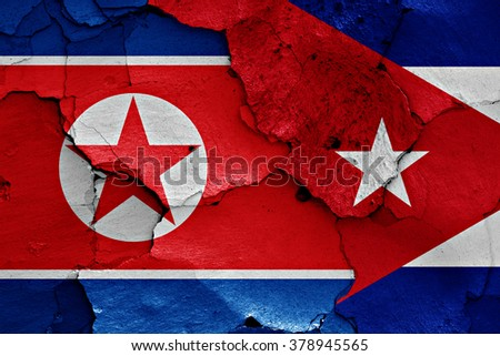 flags of North Korea and Cuba painted on cracked wall