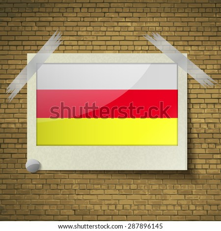 Flags of North Ossetia at frame on a brick background.  illustration. Rastrized version - stock photo